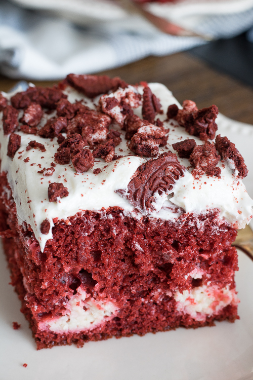 Red Velvet Cheesecake Cake, red velvet cake with a swirl of cheesecake throughout, topped with cream cheese frosting and crushed red velvet Oreos... basically the best cake EVER!